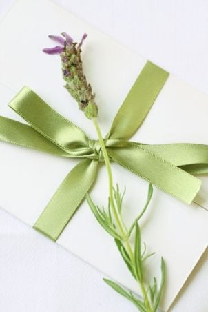 Handmade wedding invitation with fresh herbs